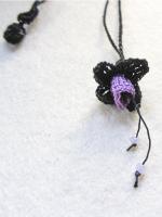sieraad bloem zwart-paars